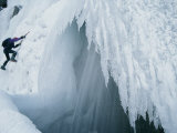 A Man Climbs Outside a Snow Cave