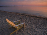 Beach Chair Facing the Water at Twilight
