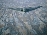 A B-2 Stealth Bomber Flies Above the Patterned Terrain of Southwestern Nebraska