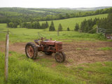 A Tractor Sits in a Farm Field on a Misty Rainy Morning in Springtime  Prince Edward Island  Canada