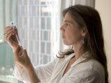 A Woman Draws Medicine into a Syringe
