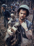 Dirty  Exhausted Looking US Marine on Patrol with His Squad Near the DMZ During the Vietnam War