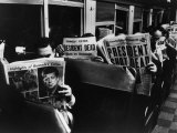 Commuters Reading of John F Kennedy&#39;s Assassination
