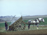 French Farmer Laying Compost on His Field from a Cart Drawn by a Percheron Horse