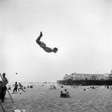 Man Flying Off a Trampoline at Santa Monica Beach