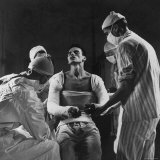 Mortar Wounded Army Medic Private George Lott  Sitting Up While 4 Army Surgeons Finish Up His Cast