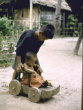 Children Playing on Wooden Wagon