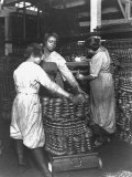 Black Women Laborers Weighing Wire Coils and Recording Weights to Establish Wage Rates  in Factory