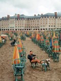 Folded Umbrellas Reflect Nearly Deserted Status of Mar Del Plata Beach