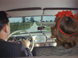 Couple Driving in Studebaker Down Country Road 1946