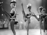 Chorus Girl High Kicking During a Performance at the Cannes Film Festival