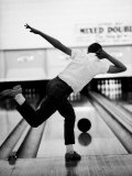 Boy Bowling at a Local Bowling Alley