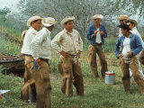 Cowboys on the King Ranch Stand Around During a Break from Rounding Up Cattle