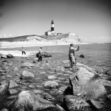 Surf Casting Fishermen Working the Shore Near the Historic Montauk Point Lighthouse