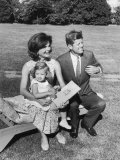 Portrait of Senator John F Kennedy with Wife Jackie and Daughter Caroline Outside at Summer Home