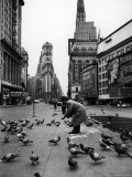 Man Feeding Pigeons in an Empty Times Square During a Taxi Strike