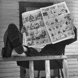 Man Reading the Comics Section of the Detroit Times on a Typical Sunday During WWII
