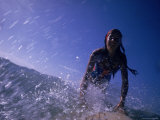 Low Angle View of a Teenage Girl Riding a Surfboard