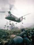 American Helicopter H-21 Hovering Above Soldiers in Combat Zone During Vietnam War