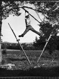 Kenneth Merriman Swinging on Tree Limb After Kicking Away Stilts