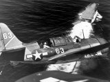 American SB2C Scout Plane Circling Above an Aircraft Carrier Prior to Landing