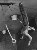 Intercollegiate Champion Gymnast Newt Loken on Flying Rings Doing Reverse Flyaway with Half Twist