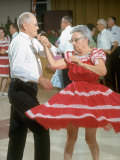 Elderly Couple Dancing  Woman's Red Skirt Swirling  in Retirement Community