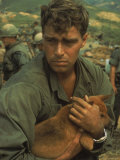 American Soldier Cradling Dog While under Siege at Khe Sanh