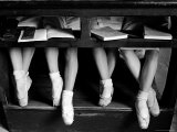 Close Up of Legs of Young Ballerinas in Toe Shoes under Desk at La Scala Ballet School