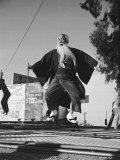 Elderly Japanese Movie Extra Jumping on Trampoline