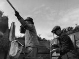 Herbert Lee Pratt Firing His Gun Toward a Grouse While the Loader Reloads Ammunition