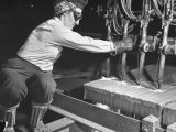 Female Steel Worker Operating Four Torch Machine to Cut Large Slab of Steel at Mill