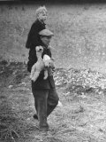 French Refugee Carrying His Little Boy  Who Clutches His Teddy Bear