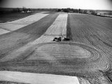 Farm Scene of Tractor in Ploughed Field