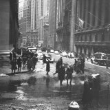 Pedestrians Crossing Slushy Intersection at Wall Street