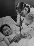 Doctor Examining Giggling Patient Recovering from Cold