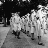 Regimental Commander Inspecting WACs and Their Stocking Seams at Assembly