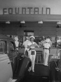 Carhops Busy with Orders at a Drive in Soda Fountain