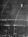 Circus Performer Alberty at Top End of 45 Ft Pole Doing a Handstand with His Feet in the Air