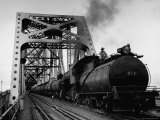 Long String of Tank Cars Rumbling Across the 4 1/2 Mile Huey Long Bridge at New Orleans