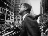 Democratic Presidential Candidate John Kennedy Speaking From Podium to Crowd in Street