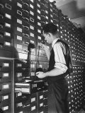 Man Looking at Film Records Containing Social Security Numbers at the Social Security Board