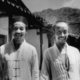 Taoist Priests Standing Outside Their Temple