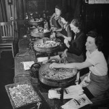 Women Counting and Bagging New Five Cent Coins