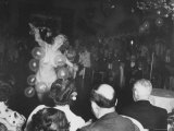 Semi Nude Bubble Dancer in Front of an Audience of Tailors and Their Wives