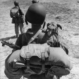US Marine Jesse Goin Carrying His Dog Towards the Front During the Fighting on Kwajalein