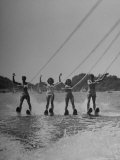 Four People Competing in the National Water Skiing Championship Tournament