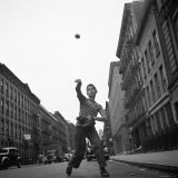 Young Boy Pitching Ball on a City Street