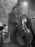Jazzman Playing a Bass in a Club