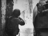 American Soldier Firing Back at Unseen German Sniper During the Battle For Cisterna
